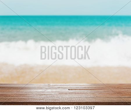Summer concept, Wood table top on blurred beach background - can be used for display or montage your products