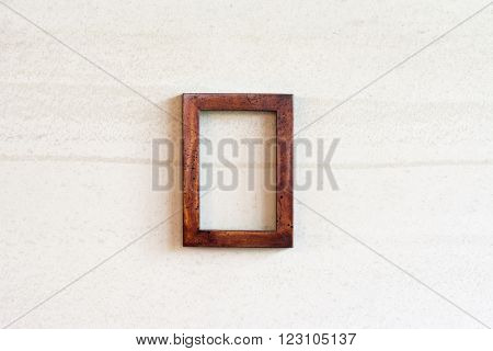 Real vintage old photo wooden frame on the wall.
