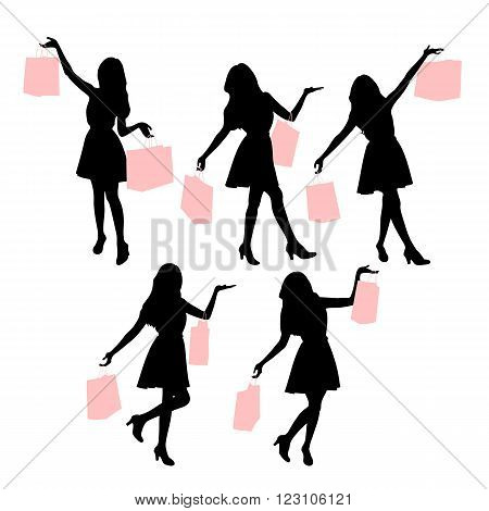 Silhouettes of shopping women hoding their paperbag