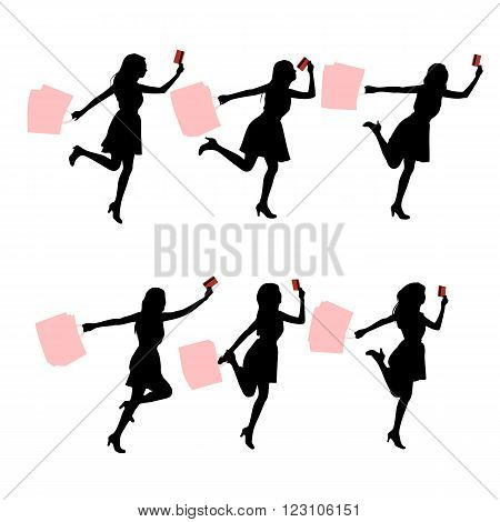 Silhouettes of shopping women hoding their paperbag and credit card