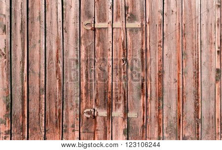 Wooden rustic background or painted wood boards texture. Boards with metal hinges. Old peeling paint. Old colored wooden boards as a background with copy space.