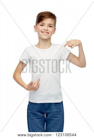 childhood, fashion, advertisement and people concept - happy boy in white t-shirt and jeans pointing finger to himself
