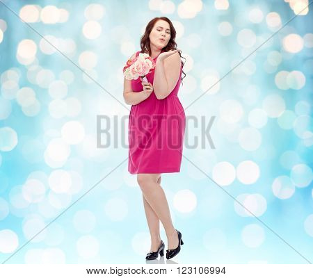 love, valentines day, holidays and people concept - smiling happy young plus size woman with flower bunch posing in pink dress over blue holidays lights background