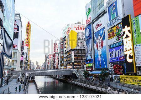 OSAKA JAPAN - NOVEMBER 20 2015 : The Glico Man light billboard and other brand logos in Dotonbori street Namba District one of famous tourist spots in Osaka Japan.