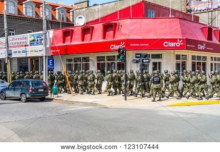 Punta Arenas Chile - December 9 2012: Chilean Army soldiers marching through the city of Punta Arenas Chile.