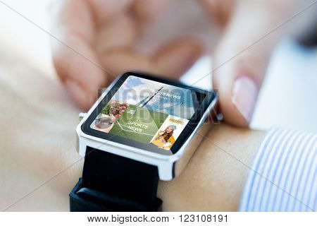 business, technology, mass media and people concept - close up of woman hands setting smart watch with news application