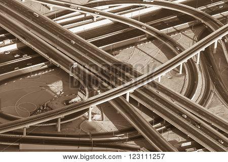 Top view of highway interchange in Dubai, UAE. Sepia toned