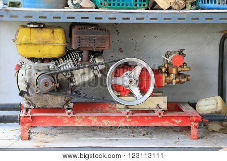 Old motors of electric generators or water-pumps on a shelf in the workshop