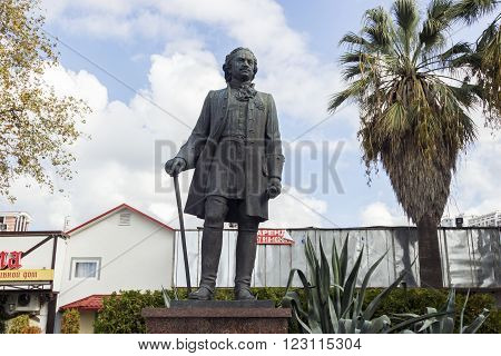 SOCHI, RUSSIA - on November 06, 2015: A monument Pyotr 1 costs with a cane in hands in a suit.