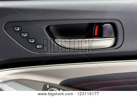 Detail of a car's door pictured from inside the vehicle