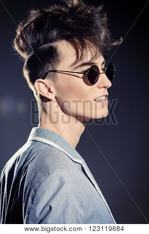 Male hairstyle concept. Fashionable young man with stylish hair. Beauty, fashion.