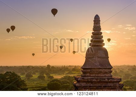 Bagan, Myanmar pagodas and hot air balloons.