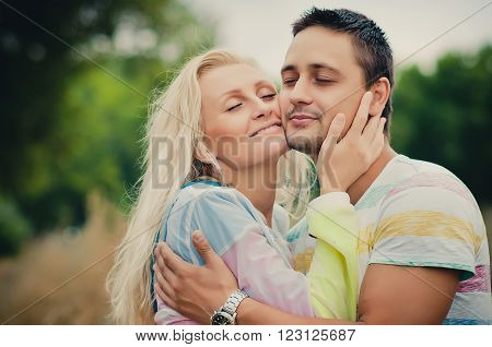 young man hugging his darling woman. Happiness together
