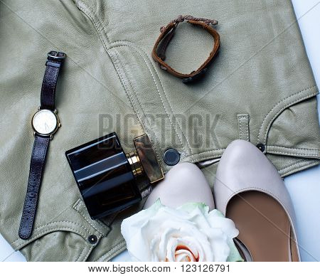 female accessories. beige shoes with perfumes and watches
