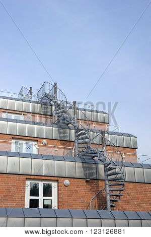 the fire escape stair which is a part of building with the sky