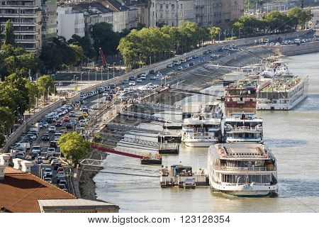 BUDAPEST, HUNGARY, JULY 10, 2015: Several restaurant and cruise boats docked at coastline of Budapest, Hungary.
