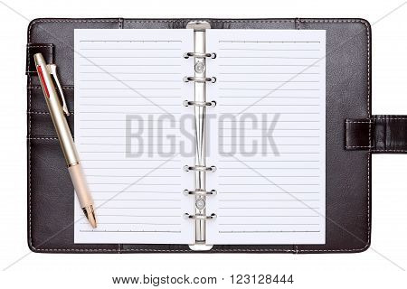 opened brown leather notebook and ballpoint pen