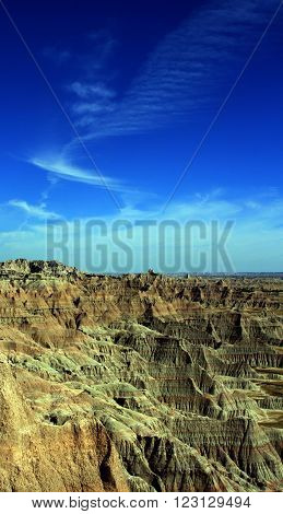 Badlands National Park under cirrus cloudscape in the Black Hills of South Dakota USA