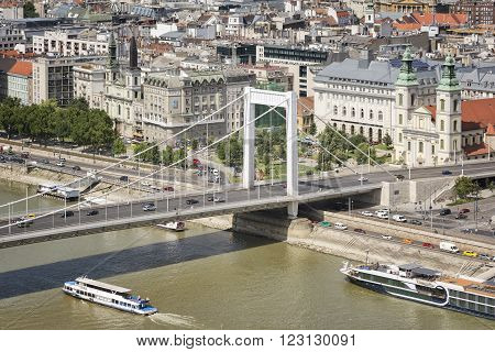 BUDAPEST, HUNGARY, JULY 10, 2015: View of Erzsebet Bridge, Inner City Parish Church and Danube river taken from Buda coast of Budapest, Hungary.