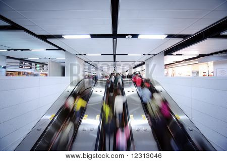 People Using Escalator