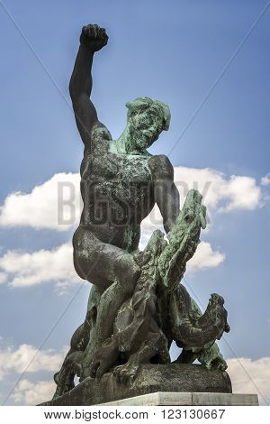 BUDAPEST, HUNGARY, JULY 10, 2015: Statue of a Hungarian warrior fighting a three headed dragon on top of Gellert Hill near the Monument Of Liberty, Budapest, Hungary.
