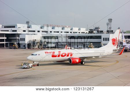 BANGKOK, THAILAND - MARCH 7 , 2016: HS-DBN Thai Lion Air Boeing 737-800 landing to Don Mueang International Airport Thailand. Thai Lion Air company is the largest low cost airlines in Thailand.