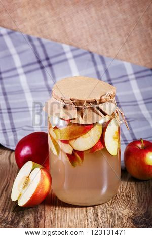 Sweet Delicious Compote Of Apples In Glass Jar On Wooden Table.