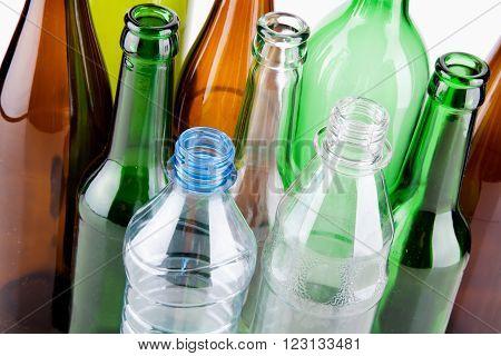 Empty bottles waste glass isolated on white background