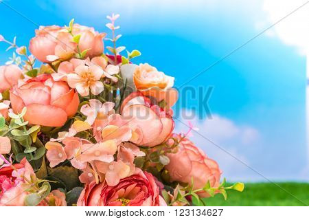 Beautiful of artificial flowers over blue sky
