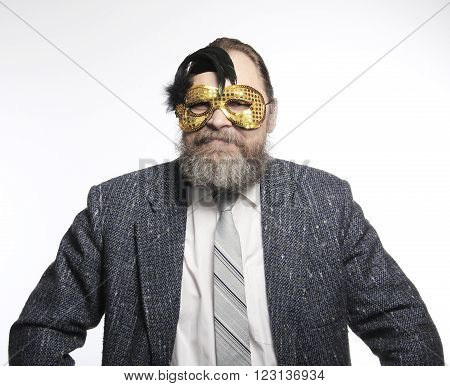 Man In Suit And Carnival Mask