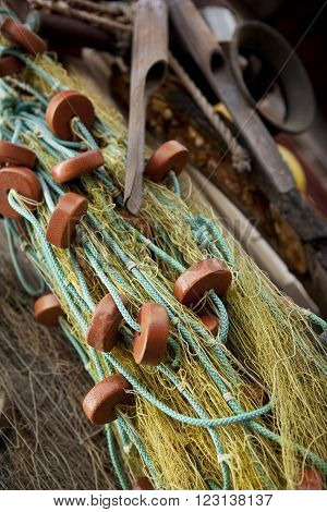 Close up on a fishing net on a wooden hall