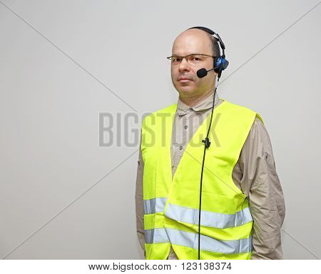 Pick by Voice Control Headset Bald Man With Glasses