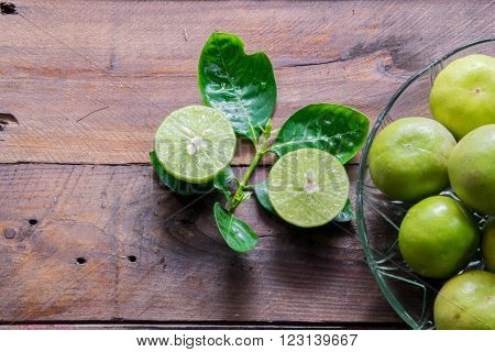 Lemons group with leaves on hard wood