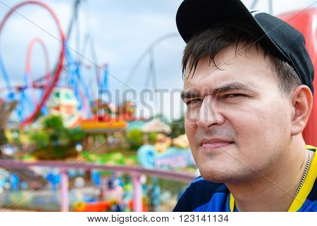 Head of a Man in a cap in an amusement park