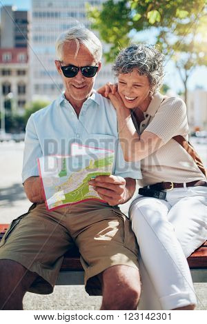 Mature Tourist Reading City Map