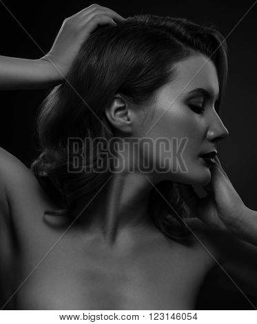 Pretty Topless Woman Posing On Dark Background.