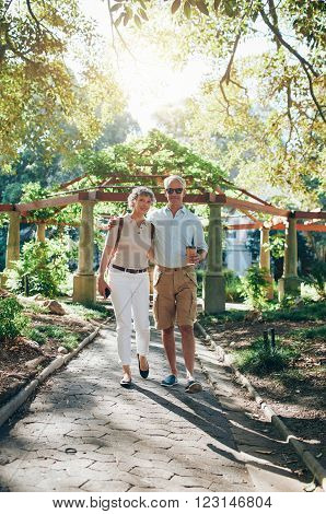 Loving Senior Couple Walking In A Park
