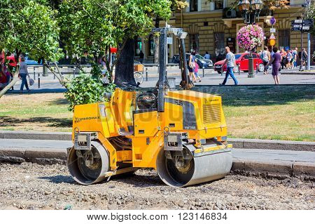 Lviv Ukraine - August 19 2015: Road roller machine at ancient historical center of Lviv