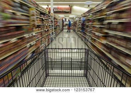 Speed Shopping / A grocery cart speeding down the aisle.