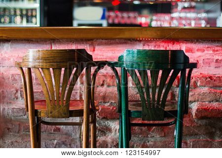 Chairs in modern cafe bar, blurred background, no people ** Note: Visible grain at 100%, best at smaller sizes