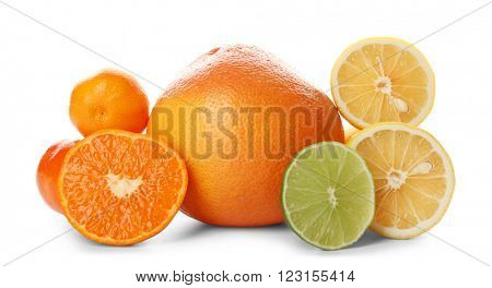 A heap of mixed citrus fruit sliced and unpeeled isolated on a white background, close up