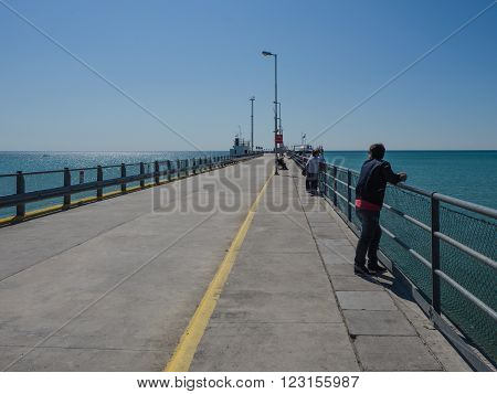 Puerto Madryn Argentina - 26th October 2015: The pier in spring with people whale watching