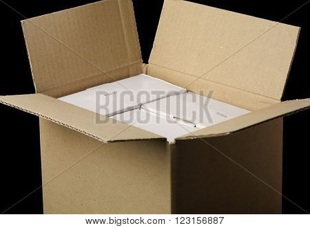 open package with white boxes and black background
