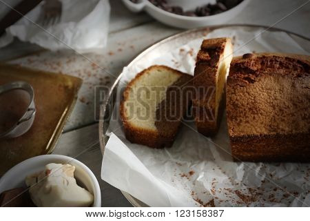 Composition of tasty cake with  nougat on wooden table background