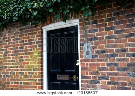 Front black Door of an English House UK