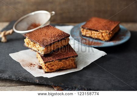 Few delicious chocolate cakes on slate plate
