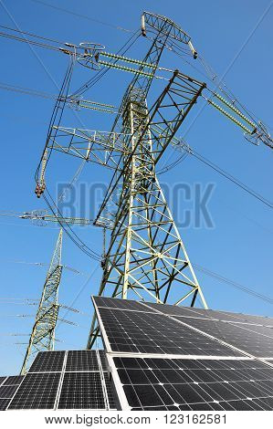 Solar panels with electricity pylon. Clean energy.