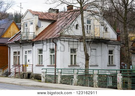 ZAKOPANE, POLAND - MARCH 09, 2016: Villa named Bright House (Jasny Domek), built of brick approx. 1905, listed in the municipal register of architectural heritage