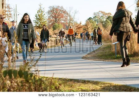 ATLANTA, GA - DECEMBER 5 2015: People walk run and bike along the Atlanta Beltline recreational area in the Old Fourth Ward  in Atlanta GA on December 5 2015.