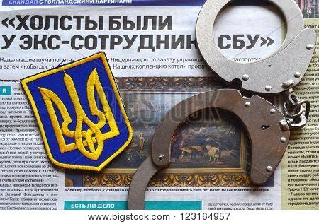 Kiev,Ukraine.FEB 20.ILLUSTRATIVE EDITORIAL.Chevron Ukrainian nazionalist battalion.Background - newspaper about West Frisian stolen art . February 20,2016 in Kiev, Ukraine